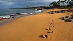 Sätt dina fotspår på Kepuhi Beach, Molokai.